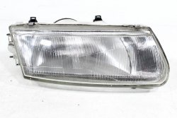 Reflektor prawy Mitsubishi Carisma DA1A 1995-1999