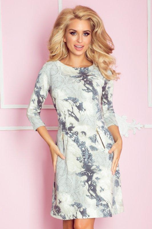 38-9 Sukienka z zamkami - ornamenty niebieskie