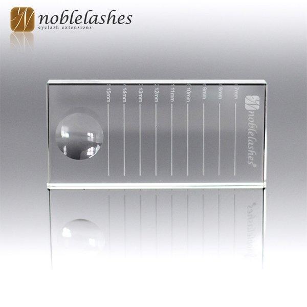 Kristallglas mit Markierungen der Wimpernlängen
