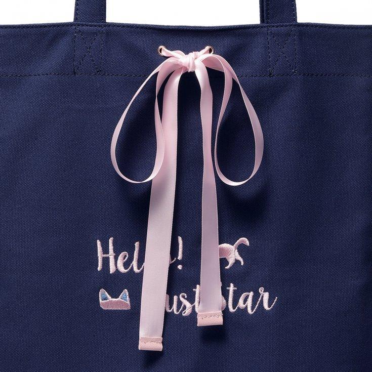 Granatowa torba na ramię z ozdobną kokardą
