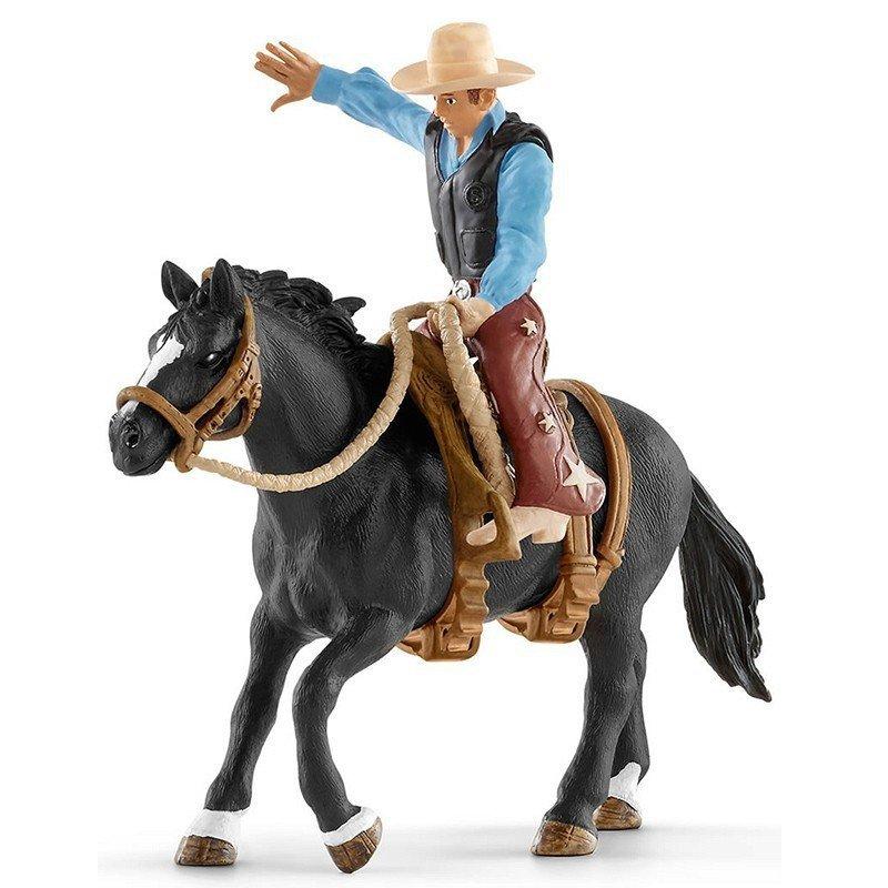 Schleich Kowboj siodłający dzikiego konia