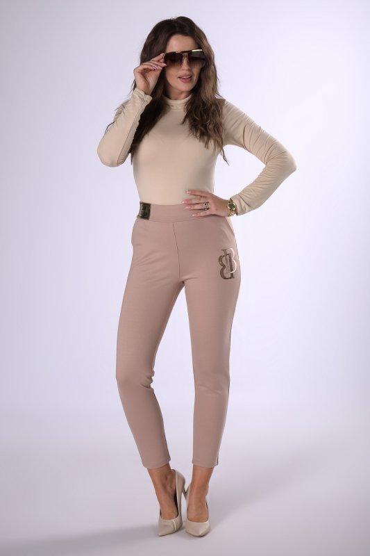dzianinowe spodnie z połyskującą aplikacją na nogawce