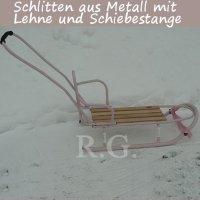 Schlitten aus Metall mit Rückenlehne Schiebestange in rosa