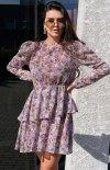 Kobieca sukienka z ozdobną falbaną