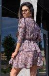 Kobieca sukienka z ozdobną falbaną tył